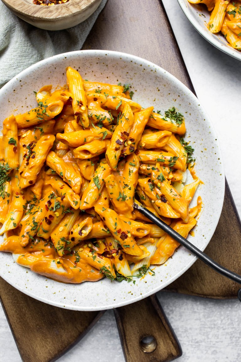 sun-dried tomato penne pasta in white bowl