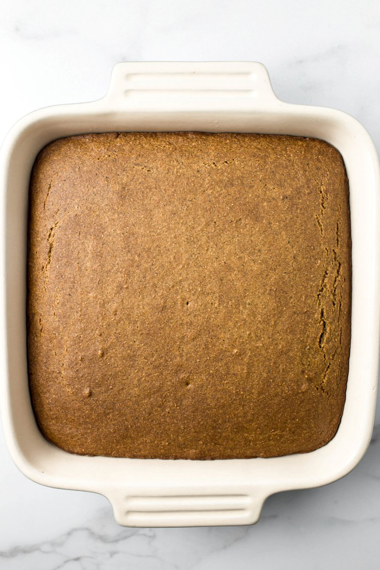 finished golden baked cake in square dish