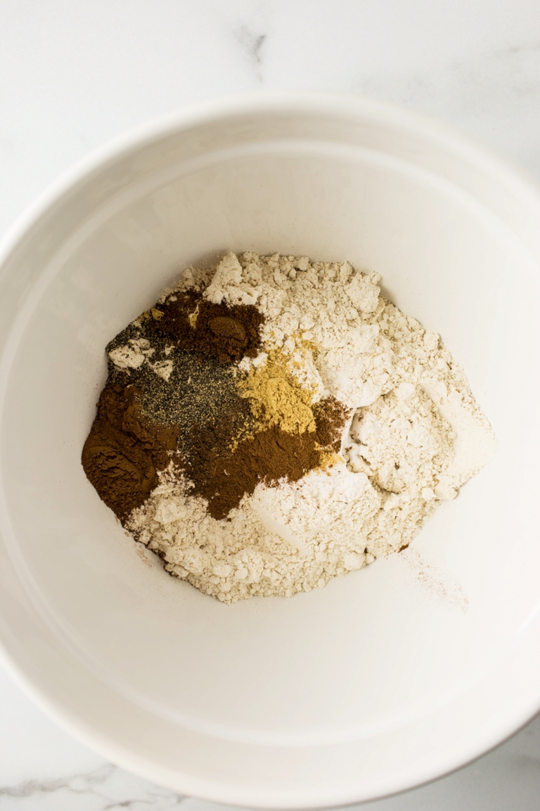 dry ingredients in white bowl for pumpkin cake