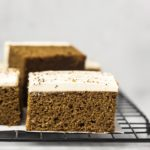 closeup front image of vegan pumpkin cake with coconut frosting