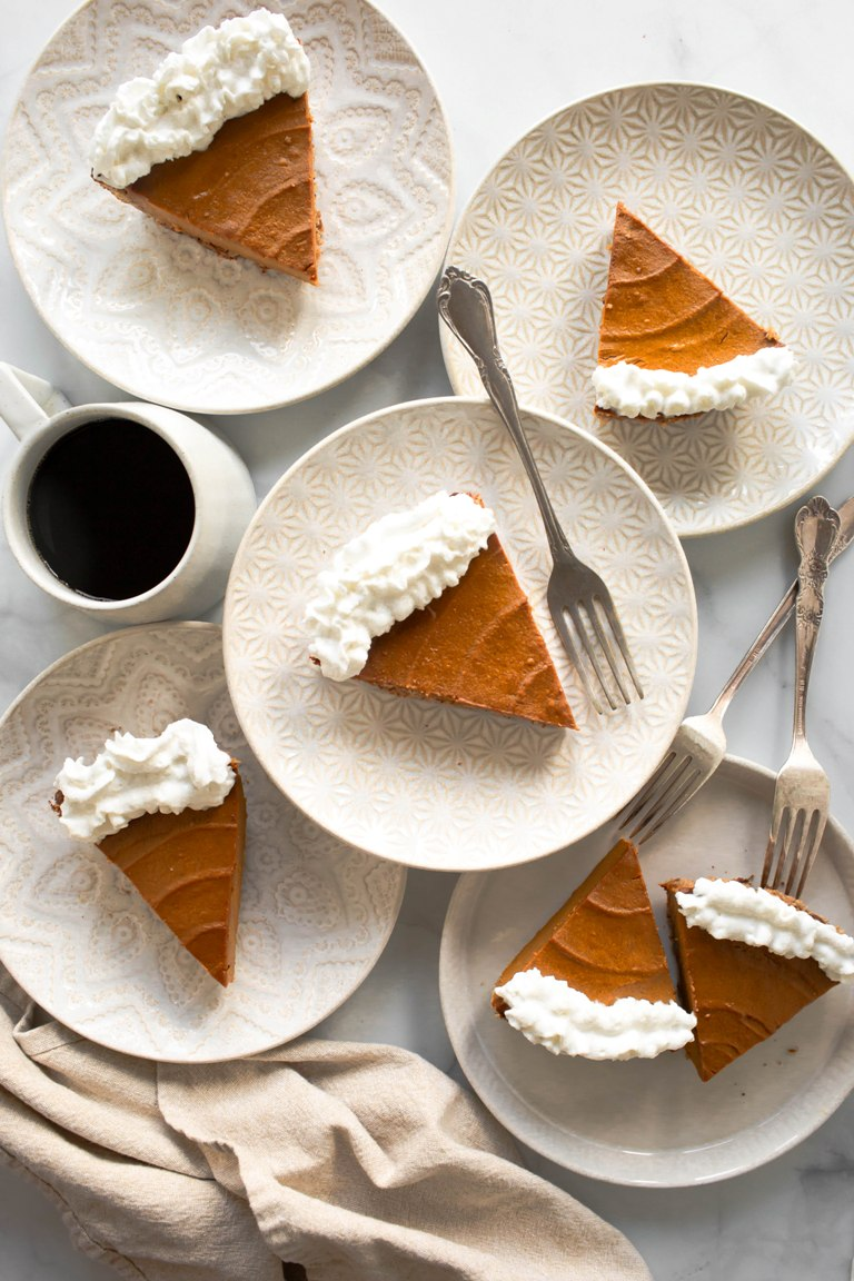 several plates next to each other with slices of pumpkin pie