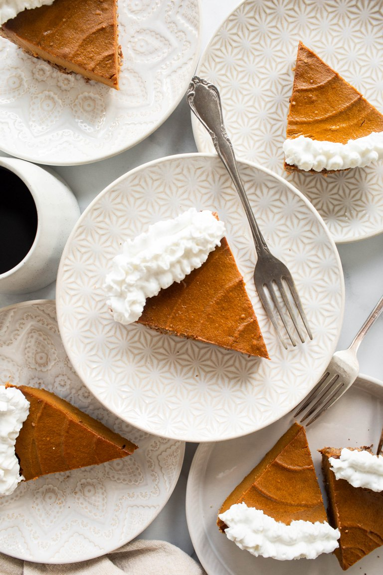 vegan pumpkin pie on white plate with fork