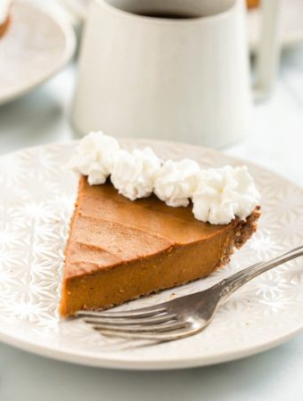 vegan pumpkin pie with whipped cream on top