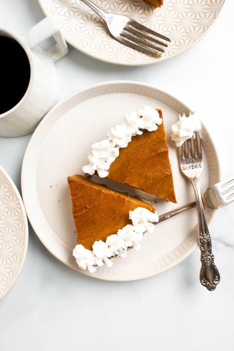 2 slices of vegan pumpkin pie on white round plate