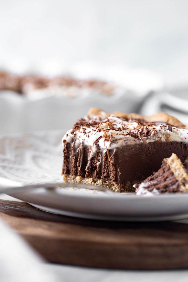 closeup of slice of vegan chocolate cream pie