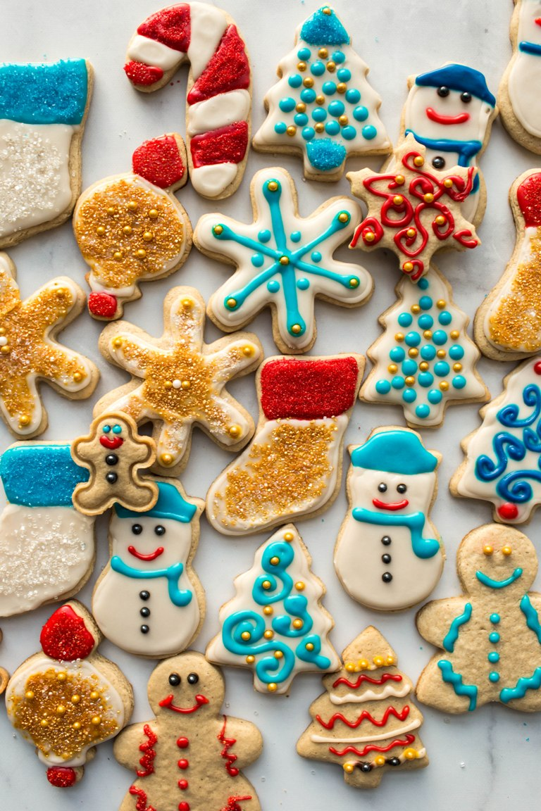 gluten free vegan sugar cookies decorated with icing on white board