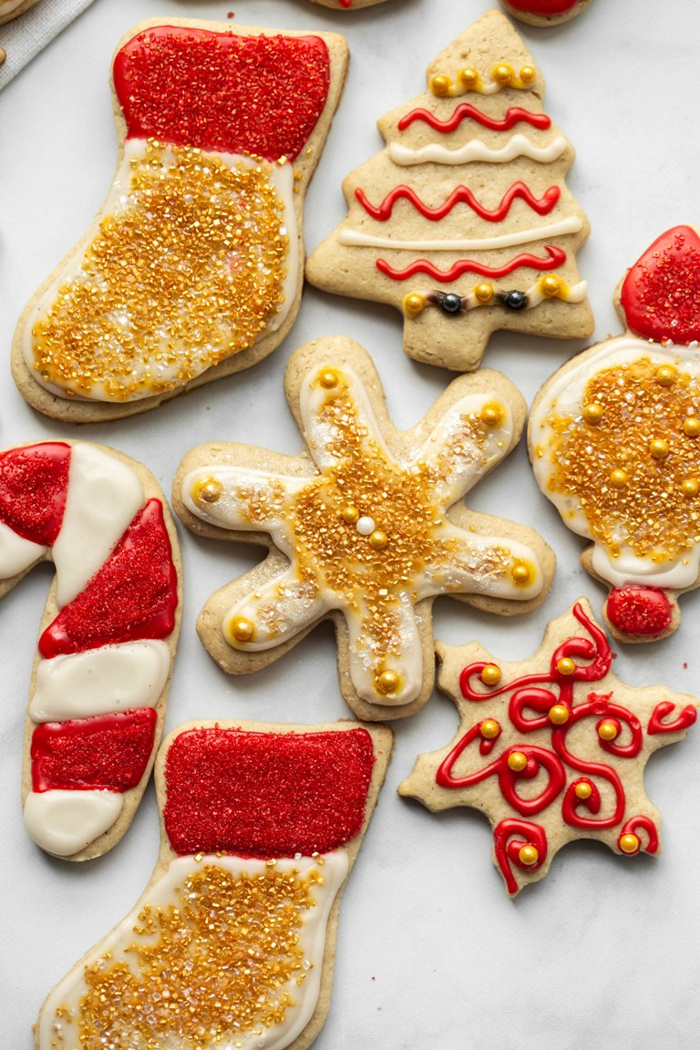 red and gold decorated vegan sugar cookies