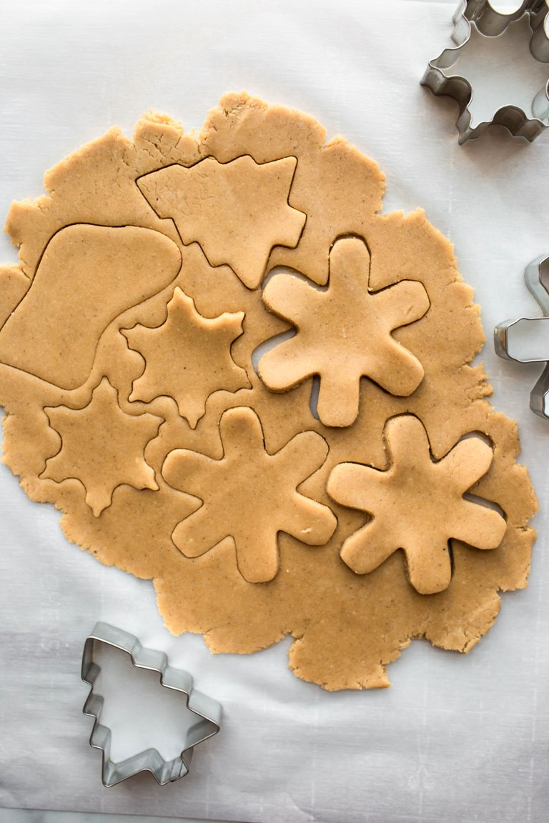 sugar cookie dough with cookie cutters
