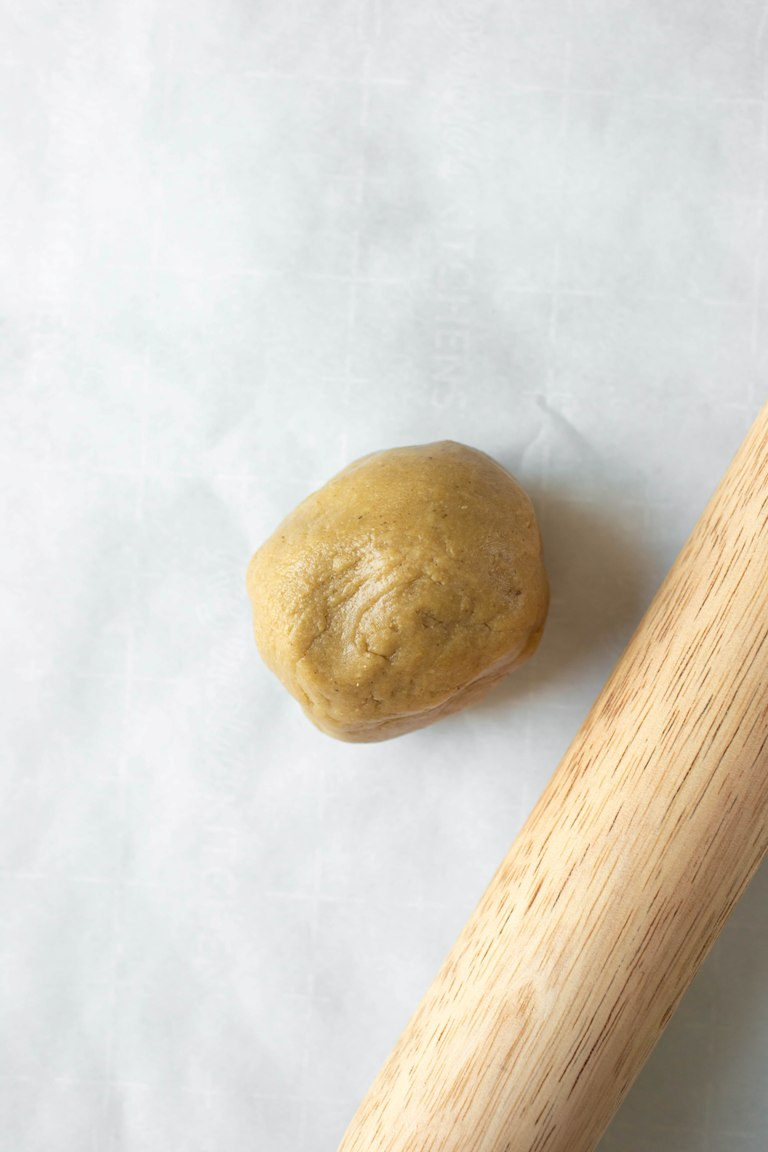 ball of sugar cookie dough with rolling pin