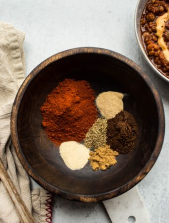 ingredients to make chili powder in wood bowl