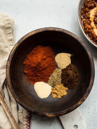 ingredients to make chili powder in wood bowl