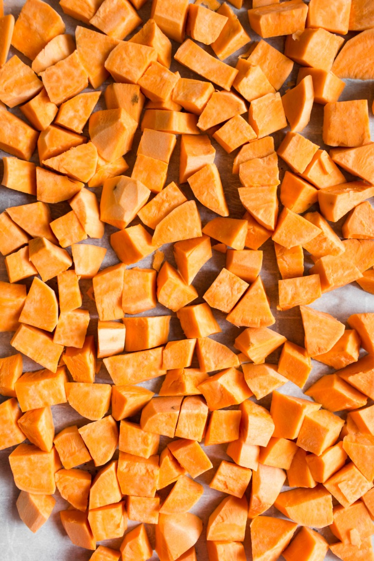 precooked cubed sweet potatoes on pan