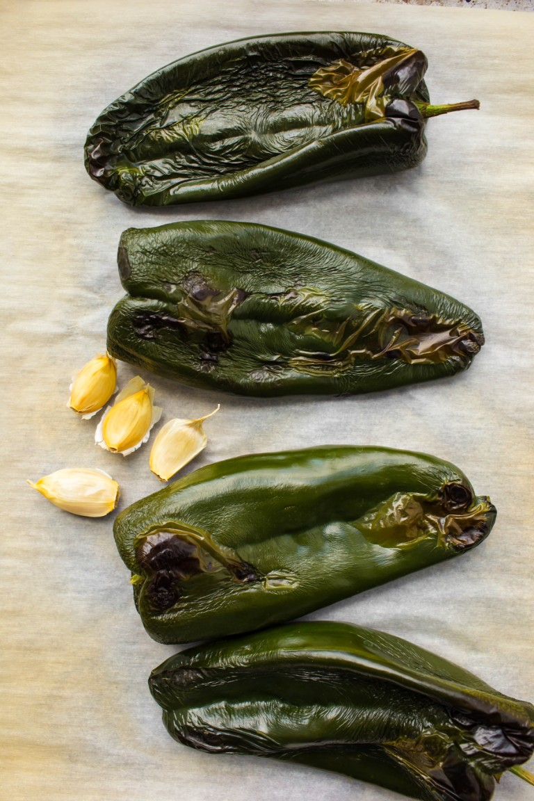 roasted and charred poblano peppers on pan