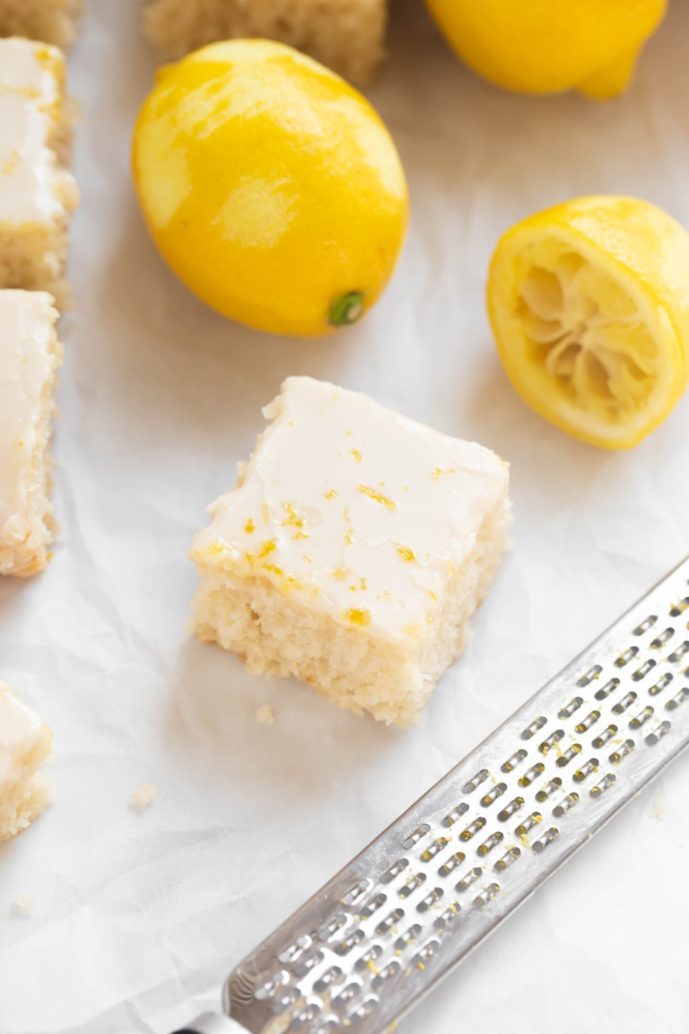 slice of cake with lemon glaze and lemon zest