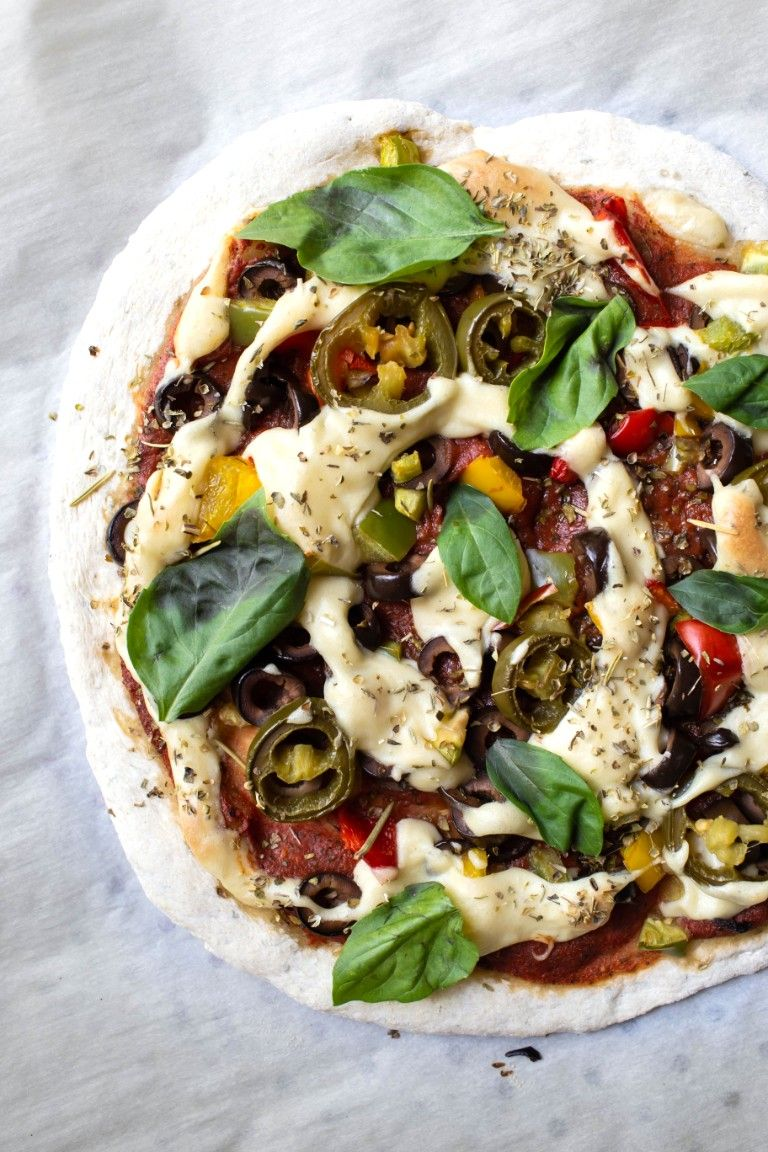 vegan pizza with toppings and mozzarella