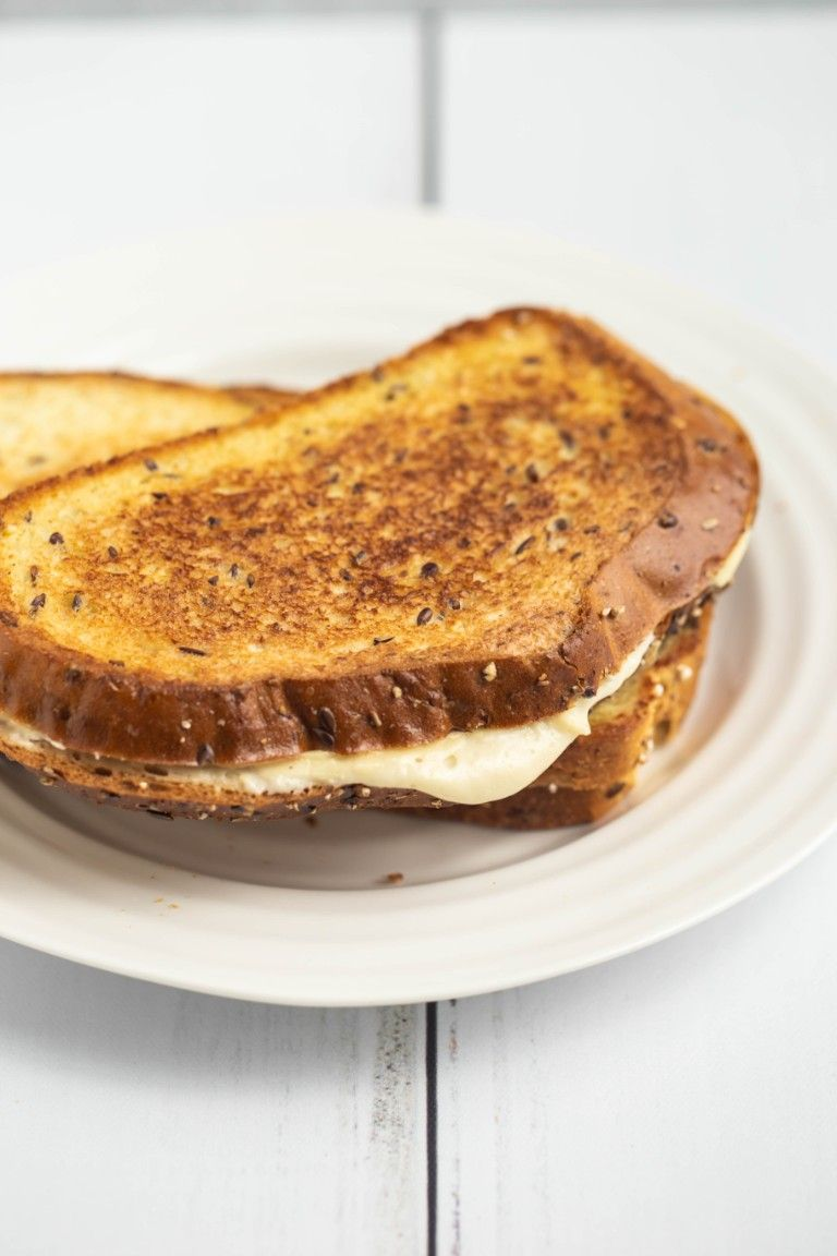 toasted grilled cheese sandwiches on white plate
