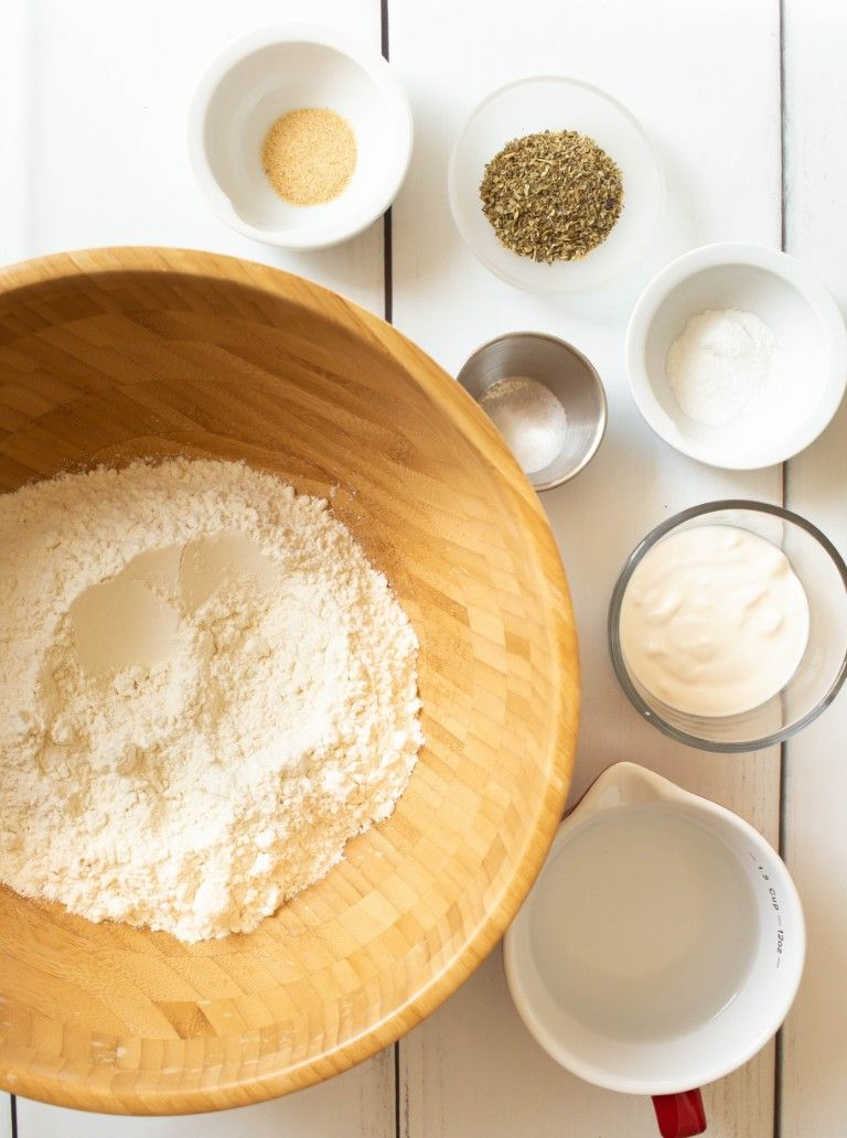 ingredients for pizza dough on white wood table