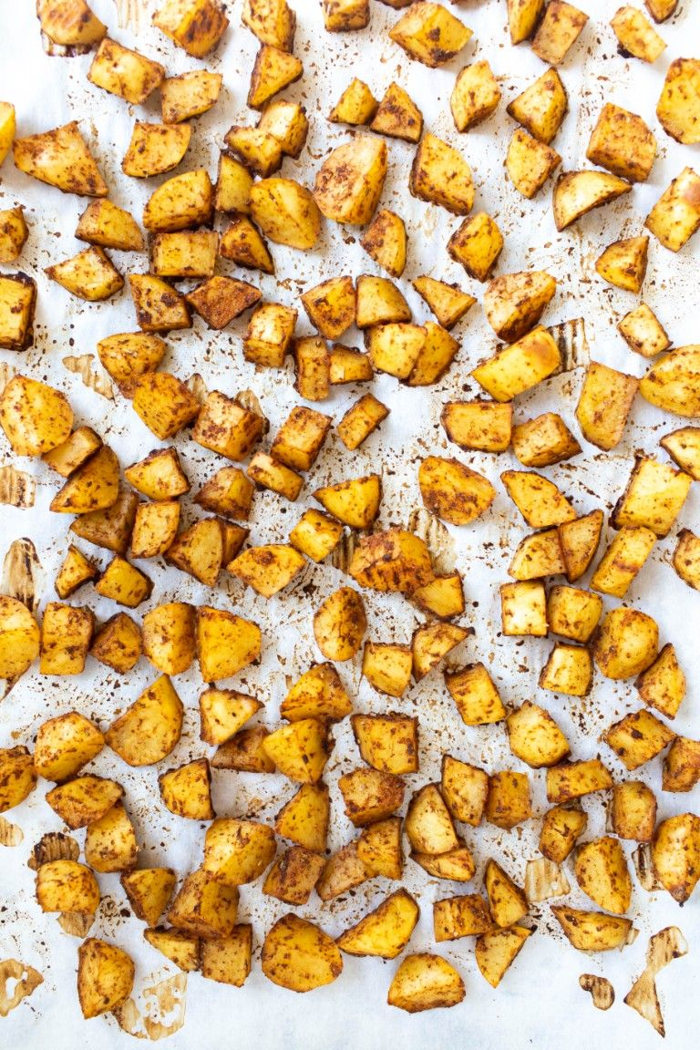 roasted potatoes on pan of parchment paper