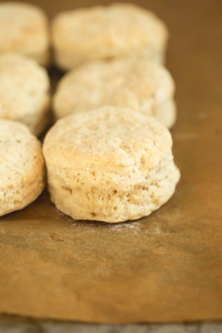 closeup of baked biscuits on pan