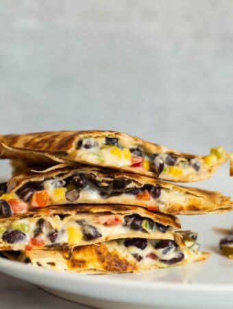 cheesy quesadillas stacked on top of each other