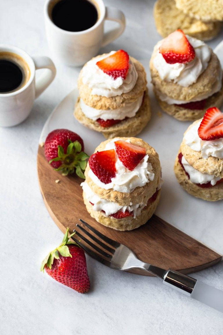 overhead view of several vegan strawberry shortcakes with coffee