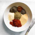 bowl of spice ingredients for Cajun seasoning