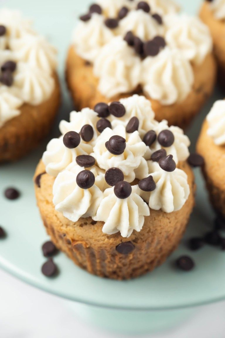 closeup shot of chocolate chip cupcake with frosting on top