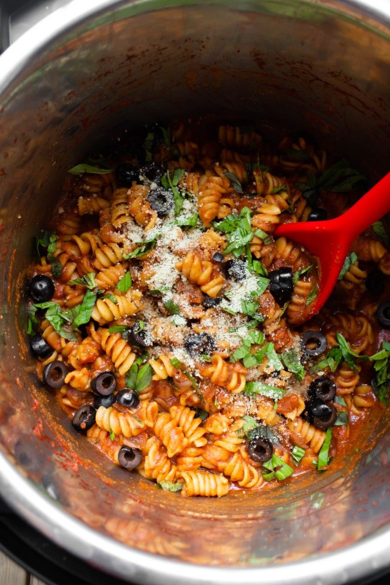 instant pot with pasta olives and fresh basil