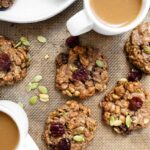 breakfast cookies with dried cherries on cookie sheet with coffee