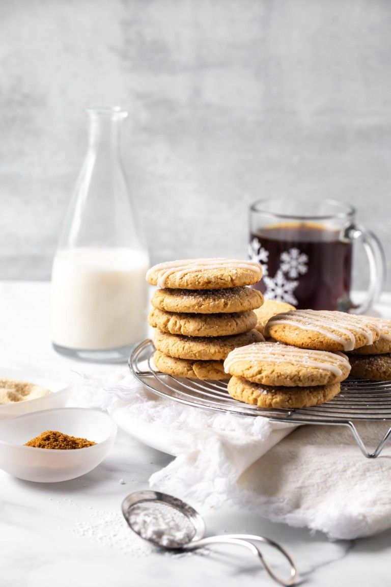 stack of cookies coffee and cashew milk on table