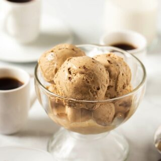 several scoops of vegan butterscotch ice cream in glass bowl