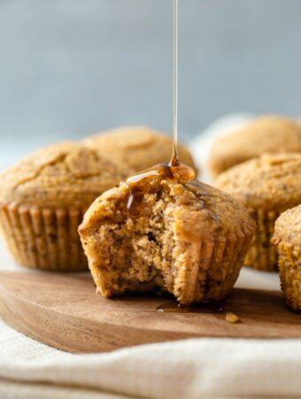 syrup drizzling down vegan cornbread muffin
