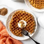 plate of waffles with dairy-free yogurt and syrup
