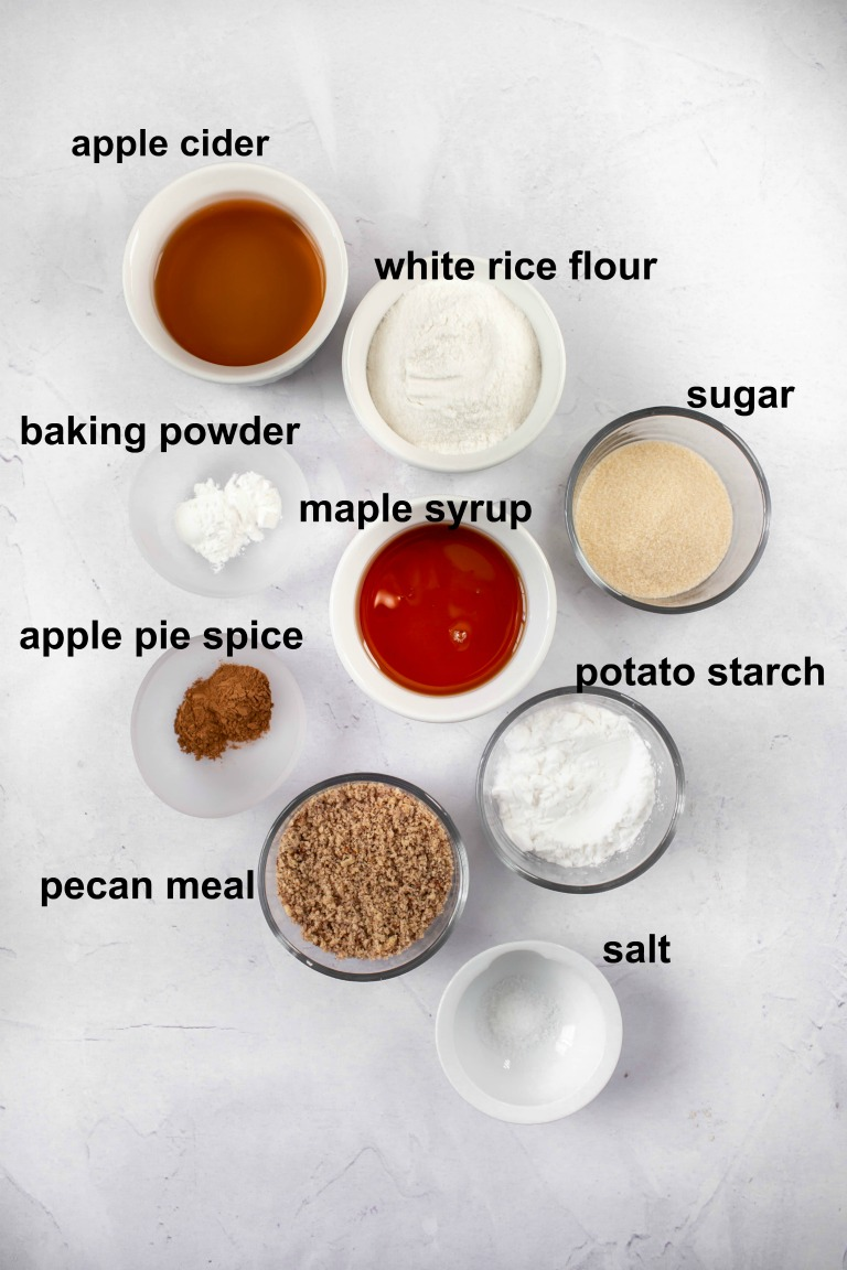 ingredients in individual bowls for vegan apple cider donuts