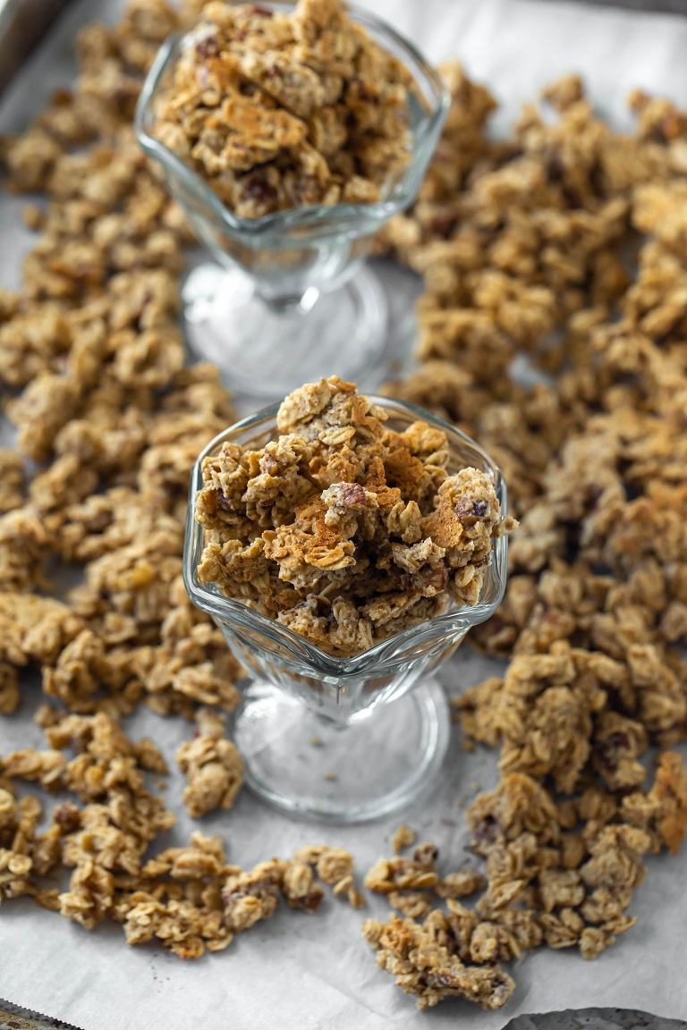 2 small glass bowls of granola on tray of granola