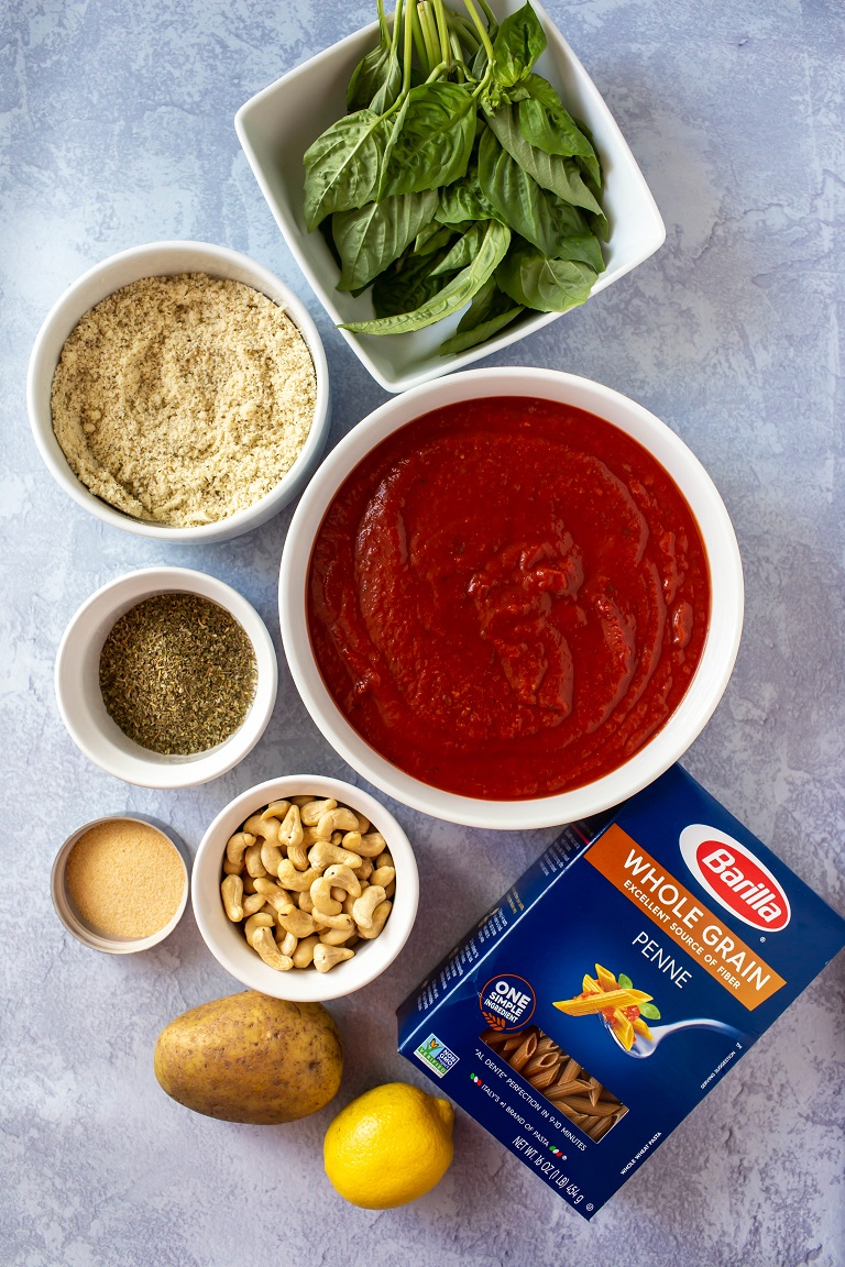 ingredients for vegan baked ziti in individual bowls