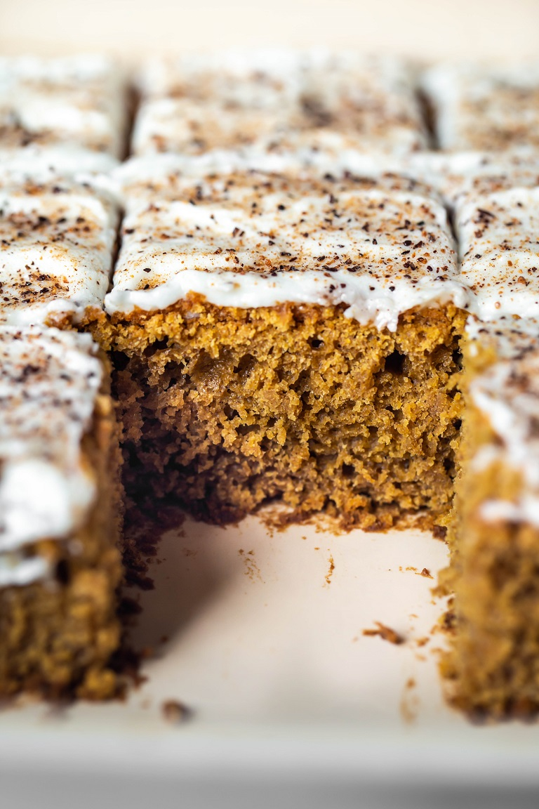 closeup of slice of pumpkin cake inside pan