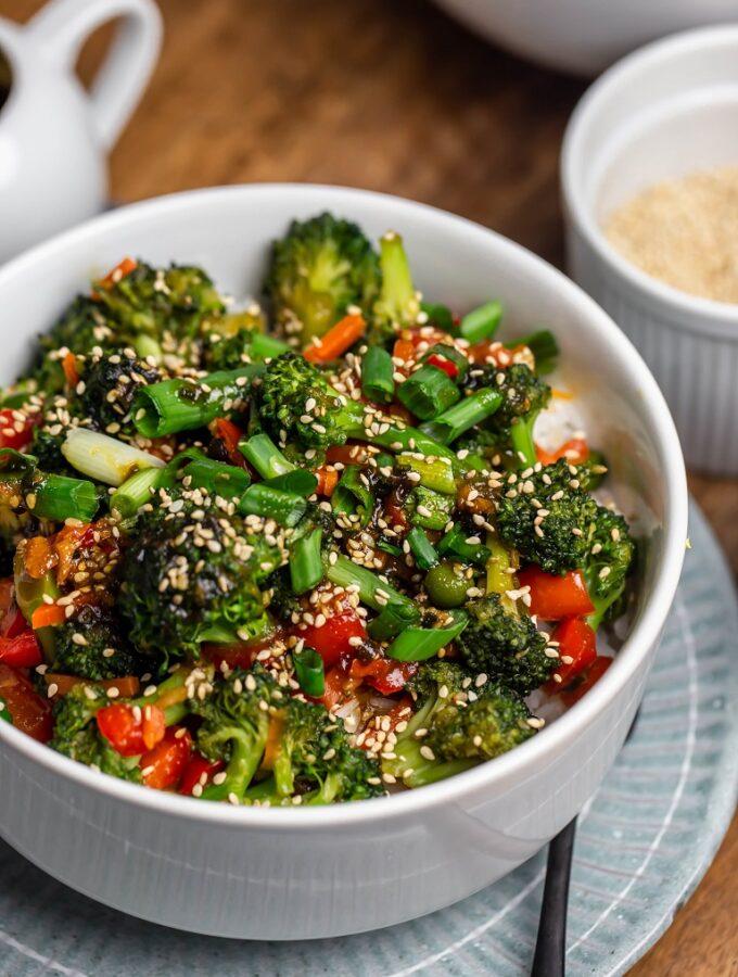 closeup white bowl of vegan teriyaki veggies over white rice