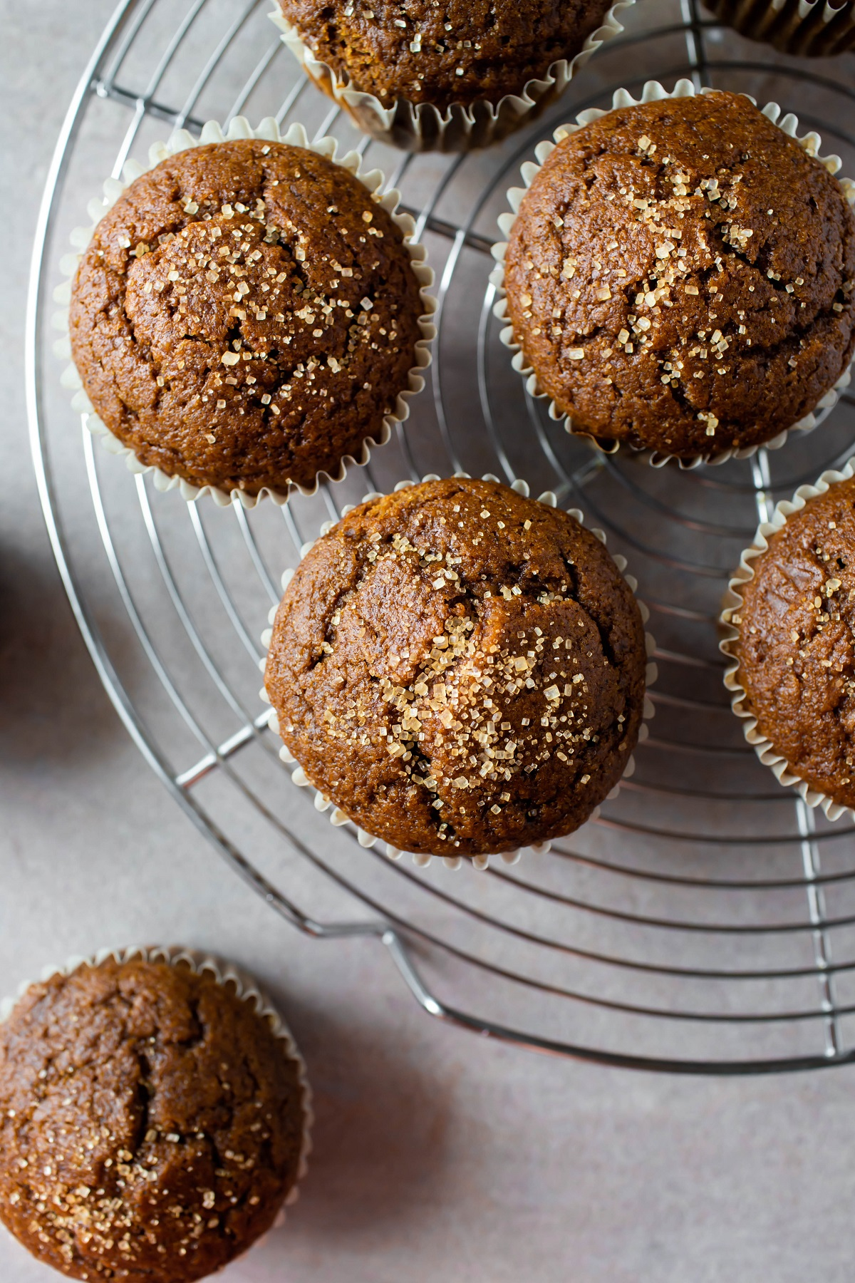 vegan gingerbread muffins on cooling rack with raw sugar on top