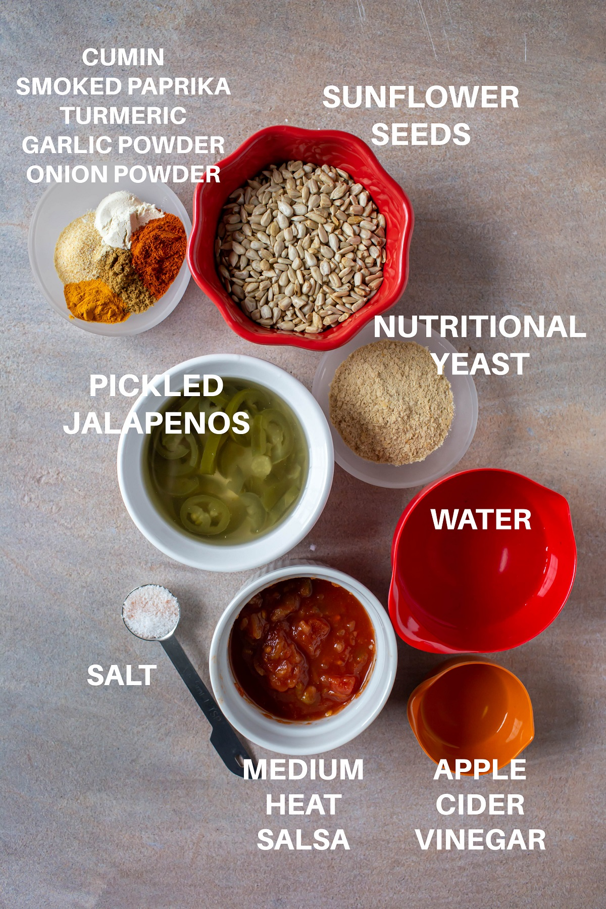 ingredients in individual bowls for vegan nut free queso